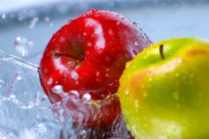 Two apples being washed